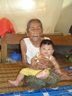 Old woman with young baby boy.jpg