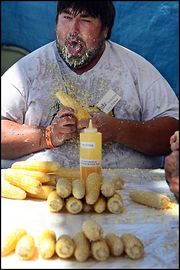 Fat-guy-eating-corn.jpg