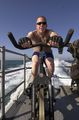 Atthew Maple, from Pittsburgh, Pa , takes time out to stay physically fit by training on a stationary bike aboard the costal patrol ship USS Sirocco (PC 6).jpg