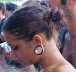 Young woman with stretched ear piercing.jpg