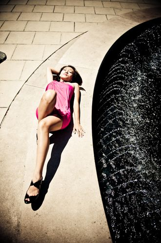 Very pretty girl getting some sun by the fountain.jpg